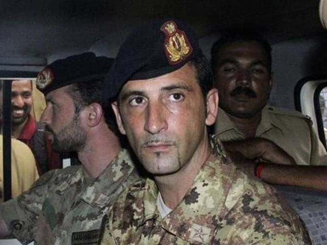File photo of Salvatore Girone in a police vehicle after appearing before a court in Kerala.