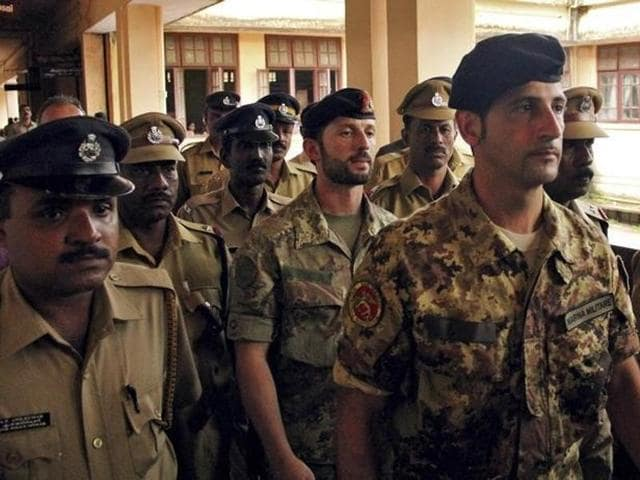 (File) Salvatore Girone (C) and Latorre Massimiliano (3rd R), members of the navy security team of Napoli registered Italian merchant vessel Enrica Lexie, are escorted as they leave a courtroom at Kollam in Kerala .