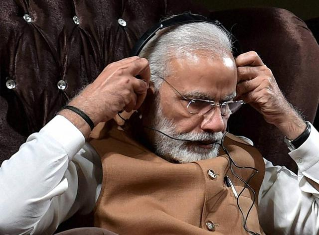"Prime Minister Narendra Modi listens to a manuscript ""Kalileh wa Dimneh"" an old translation into Persian of Panchatantra and Jataka at Vahadat hall in Tehran.(PTi)"