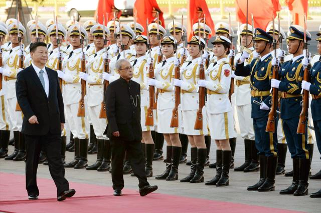 President Pranab Mukherjee shakes hands with Chinese President Xi Jinping at a meeting in Beijing on Thursday.