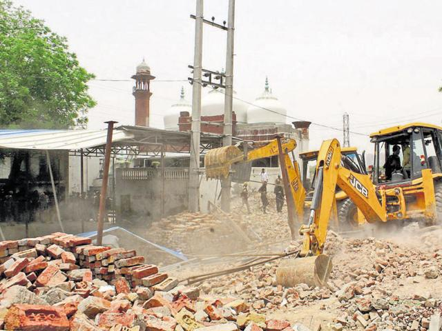 The illegal structures were demolished as per the orders of the Punjab and Haryana high court.