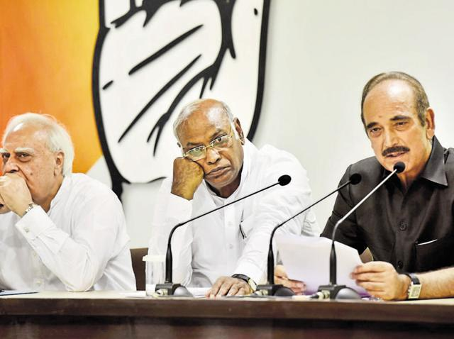 (Right to left) Senior Congress leaders Ghulam Nabi Azad, Mallikarjun Kharge and Kapil Sibal during the press conference at AICC headquarters in New Delhi on Thursday.