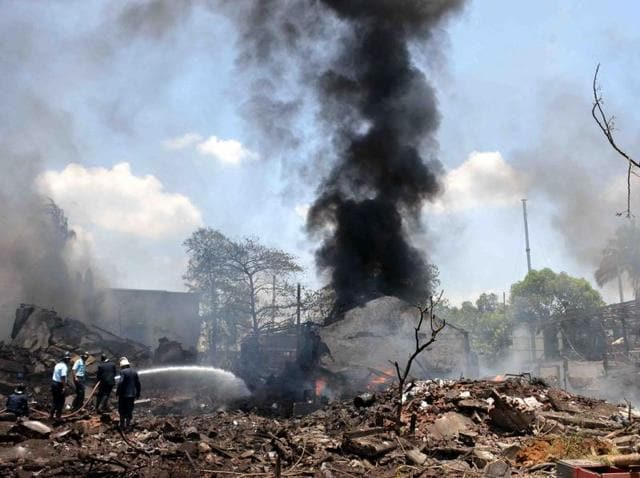 Firefighters douse flames after an explosion in Dombivli area killed six people  and injured more than 100 on May 26.  The state government plans to move chemical factories away from residential areas, but experts say the ground realities will be tough to overcome.