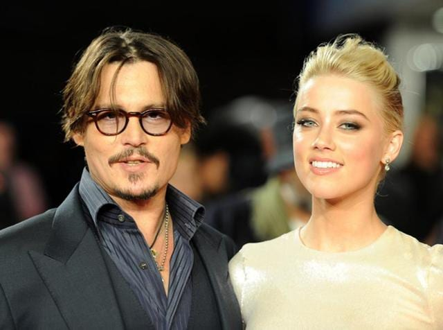 Johnny Depp and Amber Heard pose for photographers as they arrive for the European premiere of The Rum Diary. Amber filed for divorce on Thursday, citing irrevocable differences.