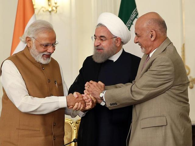 Afghan President Ashraf Ghani, right, Iranian President Hassan Rouhani, centre, and Prime Minister Narendra Modi, hold hands in a show of solidarity after their trilateral meeting and signing agreements at the Saadabad Palace in Tehran on May 23, 2016.