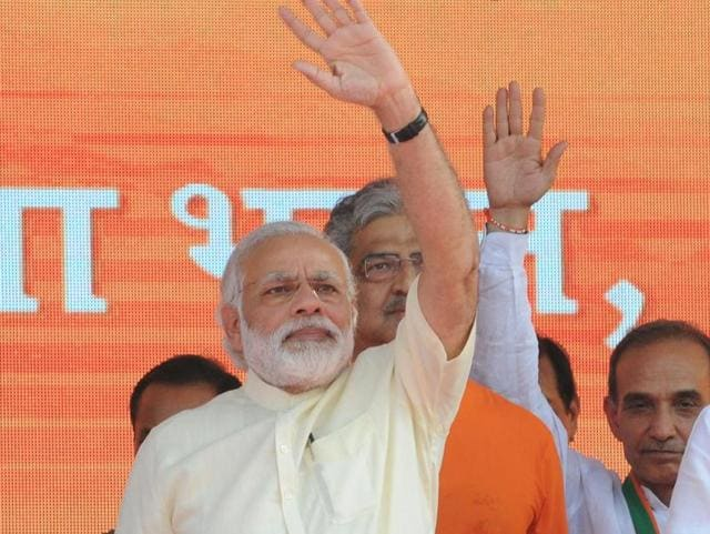 Prime Minister Narendra Modi waves towards the crowd at a rally in Saharanpur.