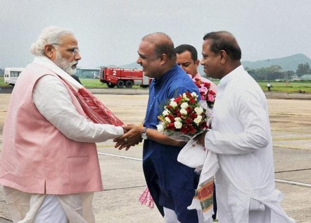 Prime Minister Narendra Modi being welcomed by Assam education minister Himanta Biswa Sarma and others after his arrival at Guwahati Airport on his way to Shillong to attend the 65th meeting of North East CMs at the North East Council, on Friday.