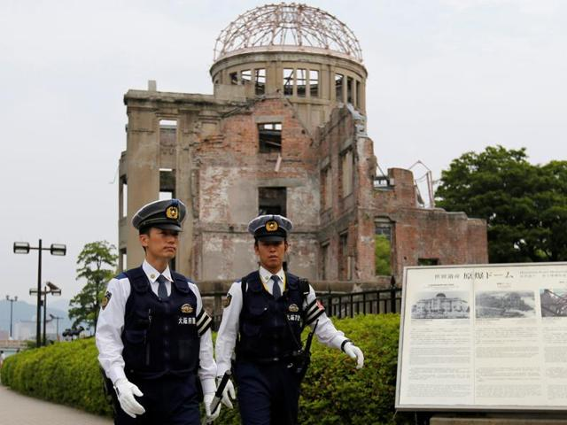 Police officers stand guard in front of the Atomic Bomb Dome at Peace Memorial Park in Hiroshima.