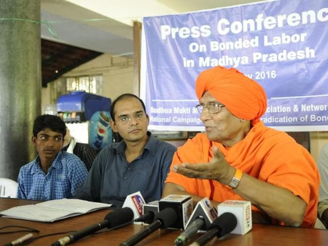 Swami Agnivesh addressing a consultation meet on bonded labour, in Bhopal on Friday.