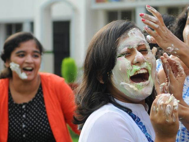 Students putting cake cream on each other during the celebration of their success after the declaration of CBSE Class 10 results at Delhi Public School campus in Ranchi on Saturday.