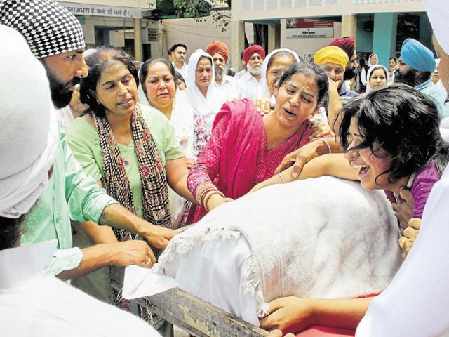 Manpreet Singh's family members at the cremation ground on Thursday.