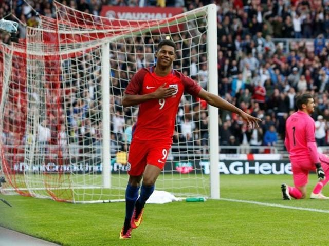 Marcus Rashford celebrates after scoring the first goal for England.