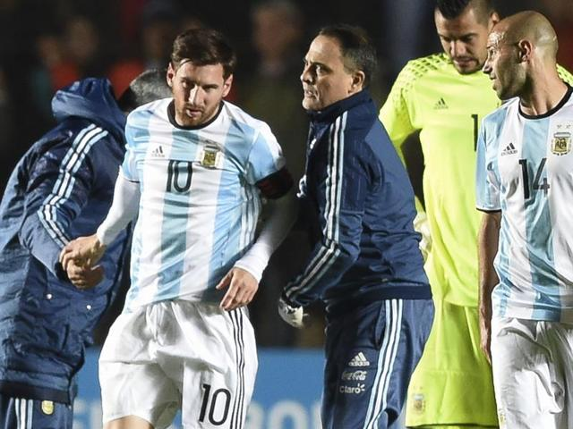 Argentina's forward Lionel Messi is assisted after being injured during a friendly football match against Honduras at Bicentenario stadium in San Juan on Friday.