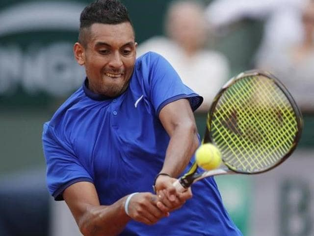 Nick Kyrgios returns the ball against Richard Gasquet.