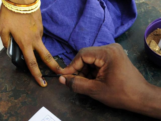 A voter's finger being marked at a polling station in Chennai on May 16, 2016, during voting in  assembly elections in Tamil Nadu.  The Election Commission postponed voting for two assembly seats for the third time on May 28,  2016.
