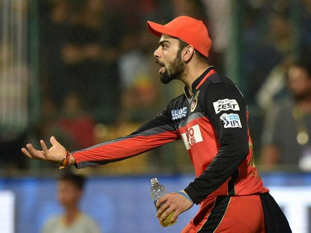 Royal Challengers Bangalore's Virat Kohli showing his hand after taking the catch of Eklavya Dwivedi during the 1st qualifier IPL 2016 match against Gujarat Lions in Bengaluru.