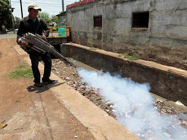 A health worker fumigates outside a home in a neighborhood after Nicaragua's government declared an epidemiological alert due to the increase of dengue cases and Zika in Managua.