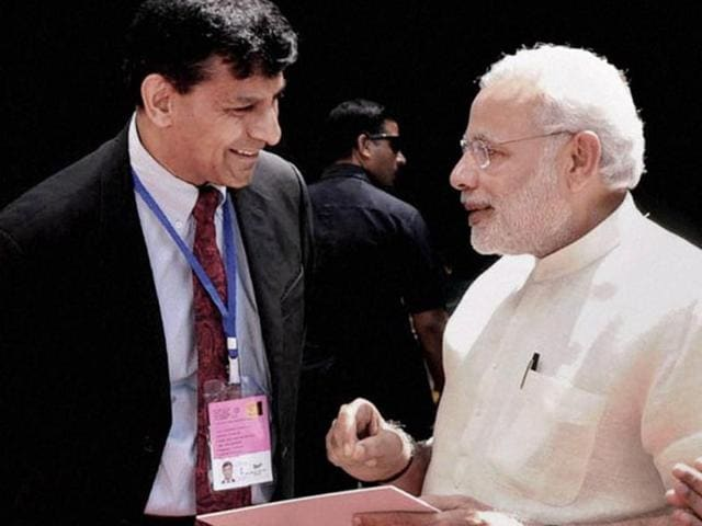 File photo of RBIgovernor Raghuram Rajan with Prim Minister Modi.  The issue of reappointment of the RBI chief has been in the news in recent months.