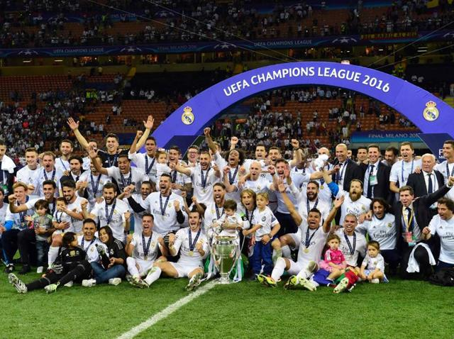 Real Madrid's players and their children pose on the pitch for a group photo as they celebrate after winning the UEFA Champions League final.