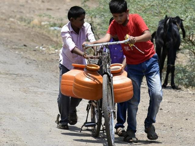 Two boys fetch water from a borewell about 3 km from their home from Taka Village, Masurdi in Latur, Maharashtra. China has offered a technology to India to artificially induce rain in the drought-hit state.