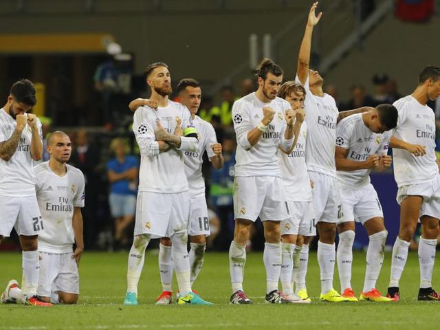 Real Madrid players celebrate during the penalty shoot out during the Uefa Champions League final match against Atletico Madrid at San Siro, Milan.
