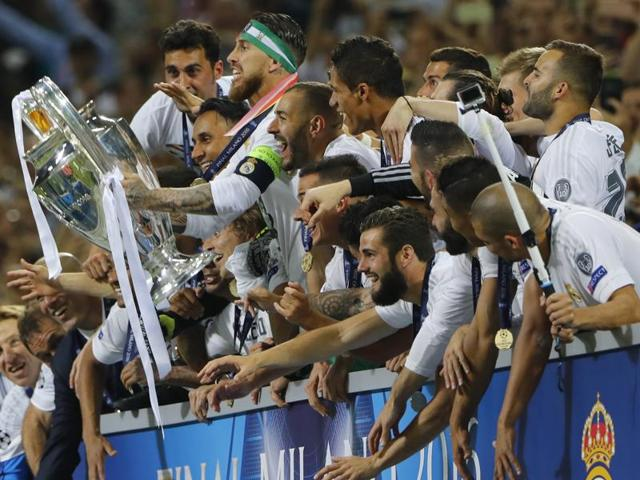 Real Madrid's Sergio Ramos lifts the trophy as they celebrate winning the UEFA Champions League.