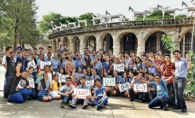 Students of different schools who scored 'perfect 10' in a jubilant mood at Rock Garden in Chandigarh on Saturday.
