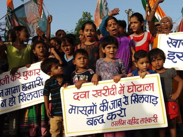 Children take part in a protest organised by Congress in Bhopal on Sunday against the death of a baby at Indore's MY Hospital when he was accidentally administered nitrous oxide.