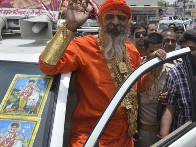 'Golden Baba' after meeting SSP , Agra at the Collectorate on Saturday, May 28, 2016. The ascetic  wears jewellery worth crores.