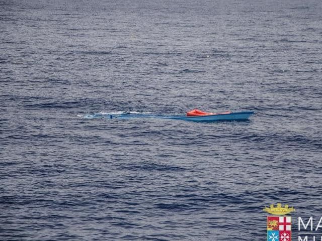 A partially submerged boat which was used by a group of migrants to reach the Italian coasts. AUN agency said on Sunday that more than 700 migrants were feared dead in three shipwrecks in the Mediterranean in the last few days.