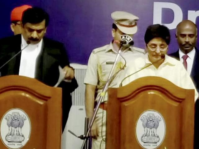 Former IPS officer Kiran Bedi being sworn in Lt Governor of Puducherry by senior judge of Madras high court Justice Huluvadi G Ramesh.