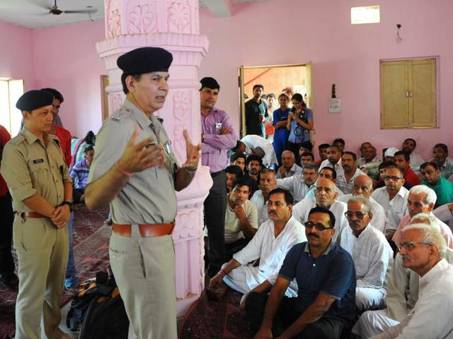 DCP (south) Ishwar Singh holds a meeting with residents of Village Maidan Garhi in south Delhi.