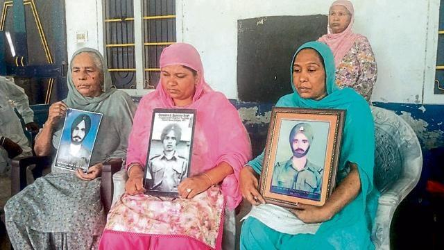 from left: Pal Kaur of Bathinda, Baljinder Kaur of Tarn Taran, Rajendra Kaur of Mansa with pictures of their relatives, languishing in Pakistani jails.