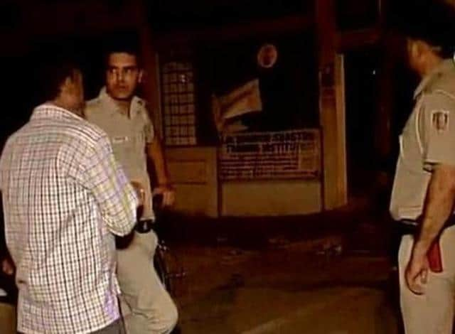 In this file photo, police officers can be seen investigating the murder of a 23-year-old African national in Vasant Kunj. (ANI Photo)