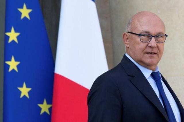 French Finance Minister Michel Sapin leaves the Elysee Palace following the weekly cabinet meeting in Paris.