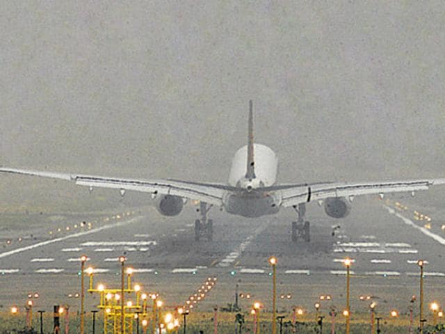 Aircraft lands at IGI Airport in New Delhi as dust envelops the sky . Photograph: Arvind Yadav/ HT