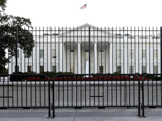 In this file photo, the White House is viewed from Pennsylvania Avenue in Washington.  The compound was placed on a security lockdown during the Memorial Day holiday after the recovery of a suspicious package.
