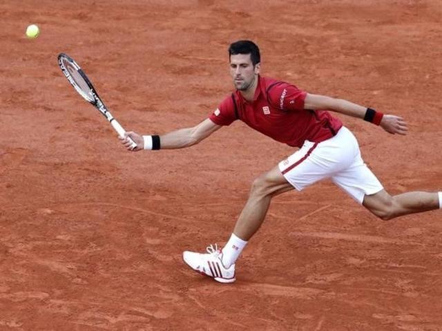 Djokovic returns a shot against Aljaz Bedene.