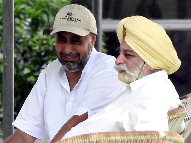 Former Punjab minister Tej Parkash Singh (in yellow turban), father of Harkirat Singh, in Chandigarh on Sunday.