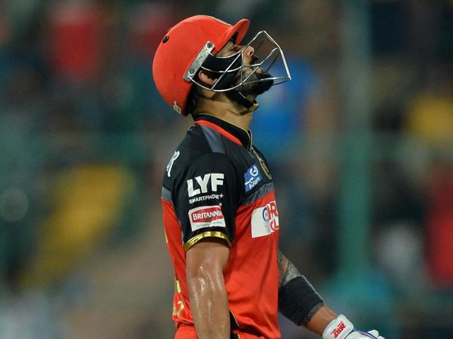 Virat Kohli looks on as he is out bowled by Barinder Sran.
