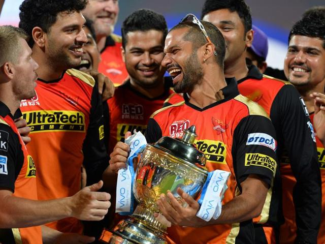 Sunrisers Hyderabad captain David Warner (L), Yuvraj Singh (2L) and Shikhar Dhawan (C) celebrate with the team, their victory against Royal Challengers Bangalore .