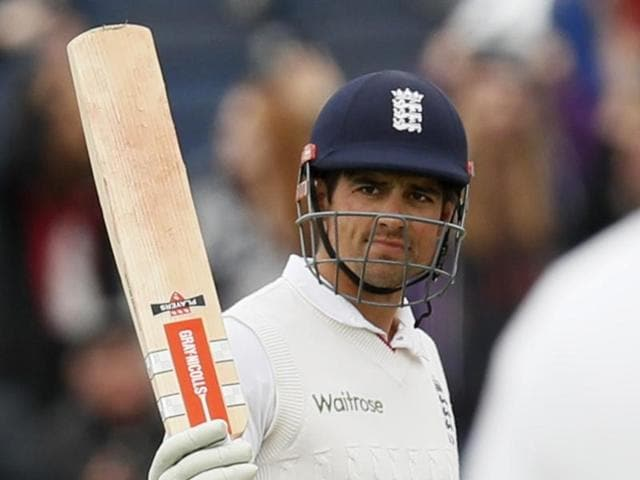 A banner is unfurled in the stands after Alastair Cook reaches the 10,000 Test runs mark.
