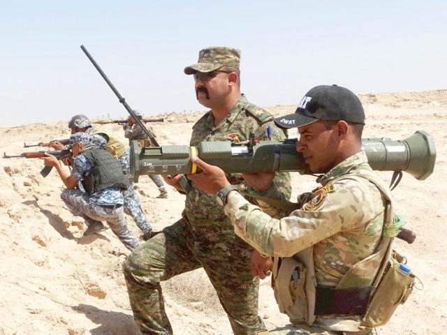 Elite Iraqi troops were poised to assault one of the Islamic State group's most emblematic bastions, Fallujah, as the jihadists counterattacked in Iraq and neighbouring Syria where thousands of civilians have fled the fighting.