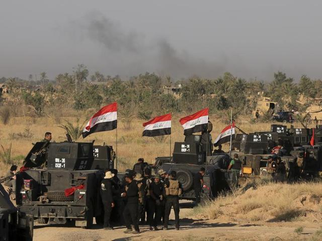 Smoke billows on the horizon as Iraqi military forces prepare for an offensive into Fallujah to retake the city from Islamic State militants in Iraq.