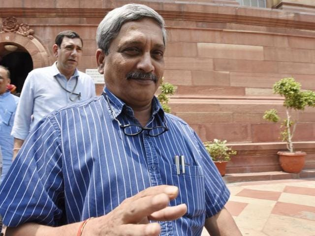Defence minister Manohar Parrikar interacts with journalists after attending the Parliament session.