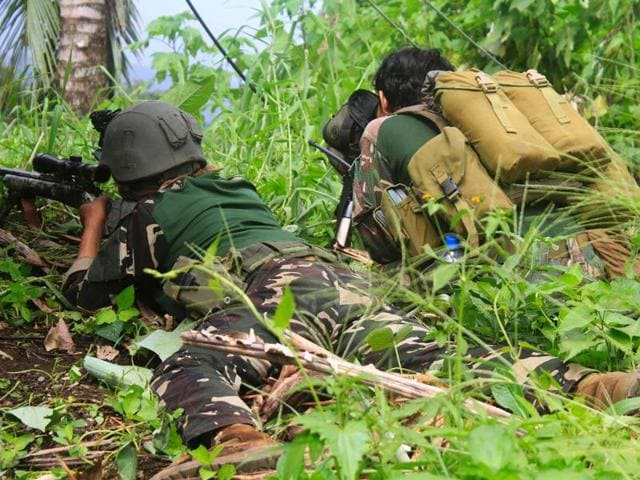 Philippine soldiers using a sniper rifle scan the horizon during an operation against Islamic militants at a remote village in Butig town, Lanao del Sur province, on the southern island of Mindanao.