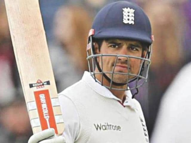 Alastair Cook celebrates after reaching 10,000 runs in Test cricket.