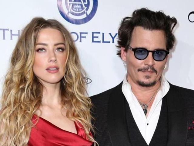 In this file photo, Amber Heard and Johnny Depp arrive at The Art of Elysium's Ninth annual Heaven Gala at 3LABS, in Culver City, Calif.
