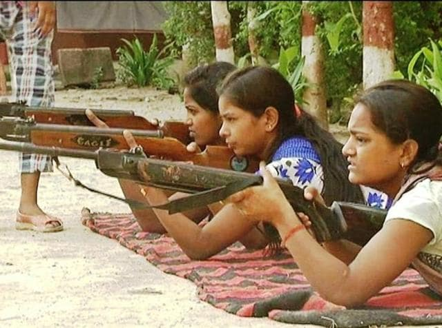 Volunteers of Durga Vahini ,  the VHP's women's wing, undergoing weapons at a camp in Varanasi. An FIR has been filed against a VHP leader and some others for    organising the camp .