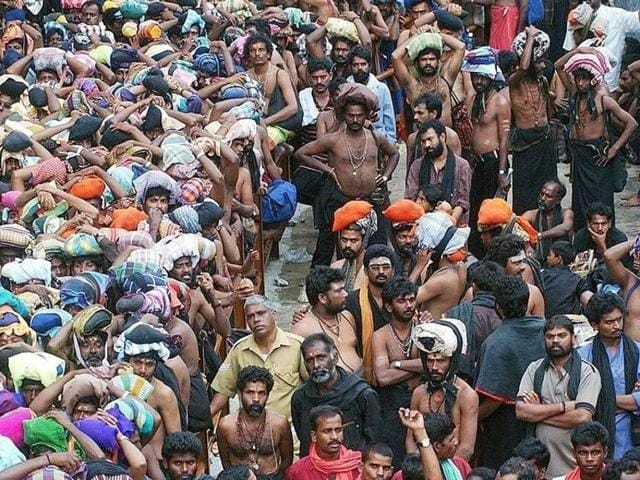 Hindu devotees wait outside the Sabarimala Temple to offer prayers for the Lord Ayyappa in Pathanamthitta in Kerala.